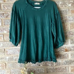 Emerald green balloon sleeve top with lace trim